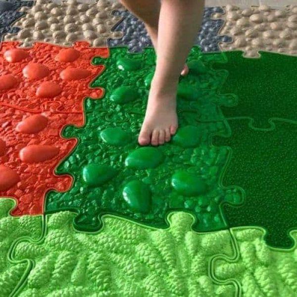 Kid steps on a Muffik sensory play mat