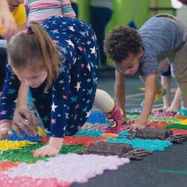 Children play on a sensory Muffik path during a session in therapy