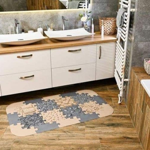 Muffik Orthopedic mats set in front of a bathroom cabinet in brown grey