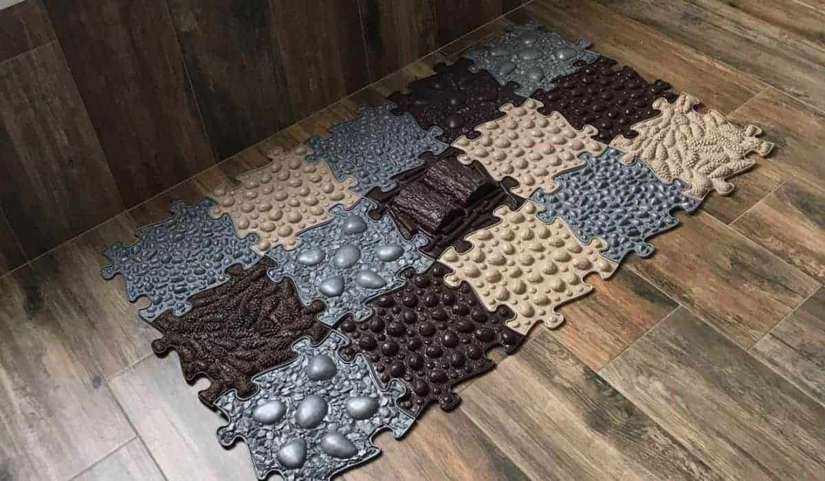 Muffik Orthopedic mats set on the floor in front of a bath in brown colourn grey
